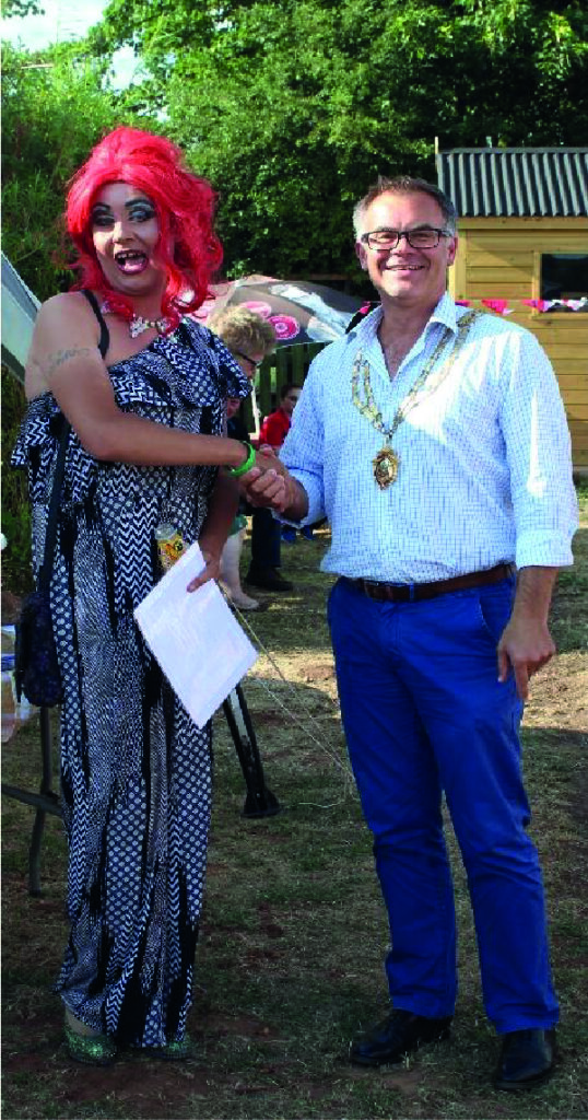 President of Chamber of Commerce being upstaged by cross-dressing volunteer