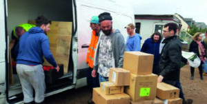 Volunteers and staff work to unload food from Fareshare delivery for Community Café and Community Pantry